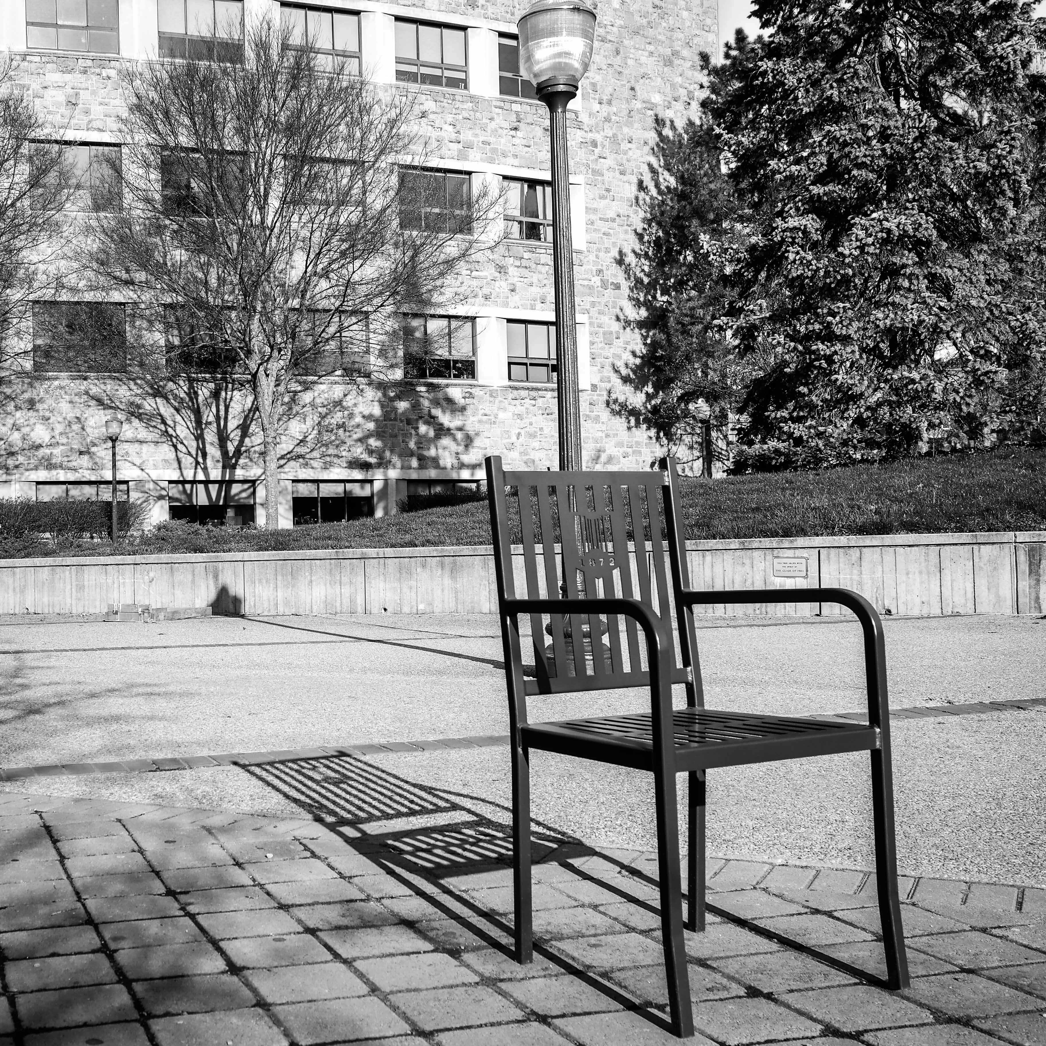 A black and white picture of an empty chair