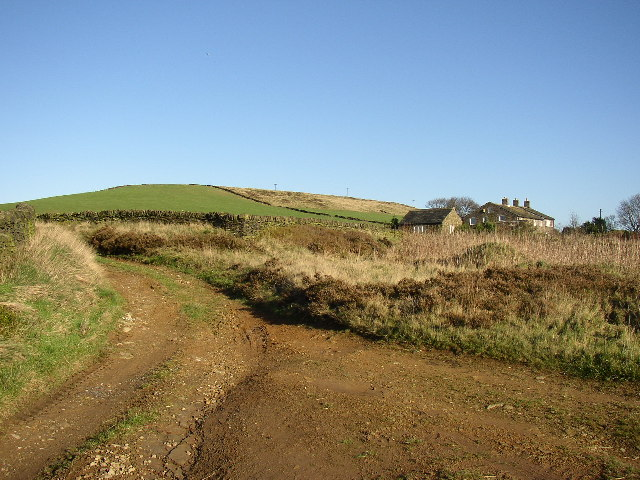 Footpath, Worts Hill and West End, Slaithwaite. A tarmac lane leads to a series of farmhouses along the hillside, the last of which is West End. Then the lane becomes the footpath in the foreground. The hill is Worts Hill. A bridleway crosses it near to the summit and gives excellent views.