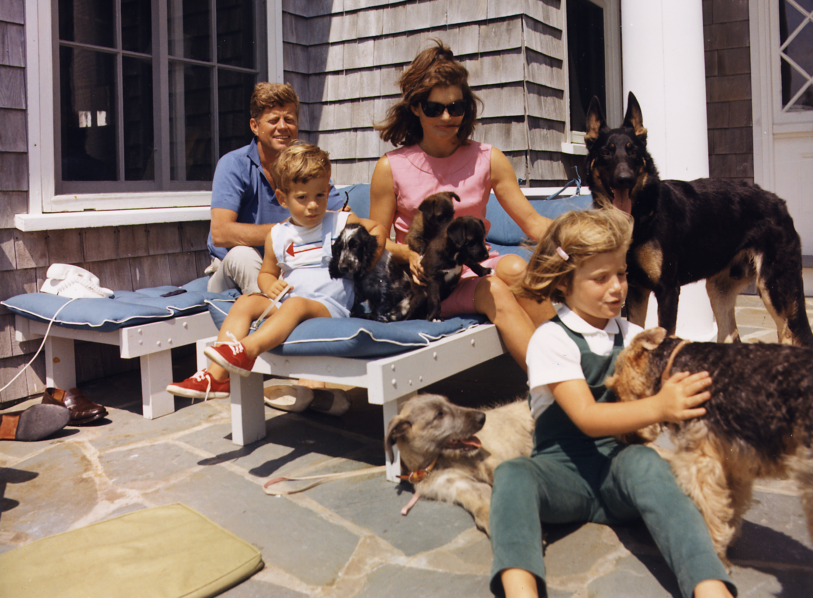 The Kennedy family with their dogs in Hyannisport, 1963.