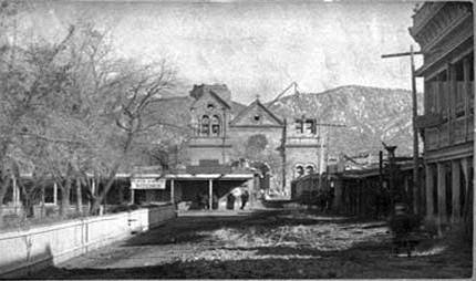 The re-construction of the St. Francis Cathedral with the plaza visible (1885) Santa Fe (1885).jpg