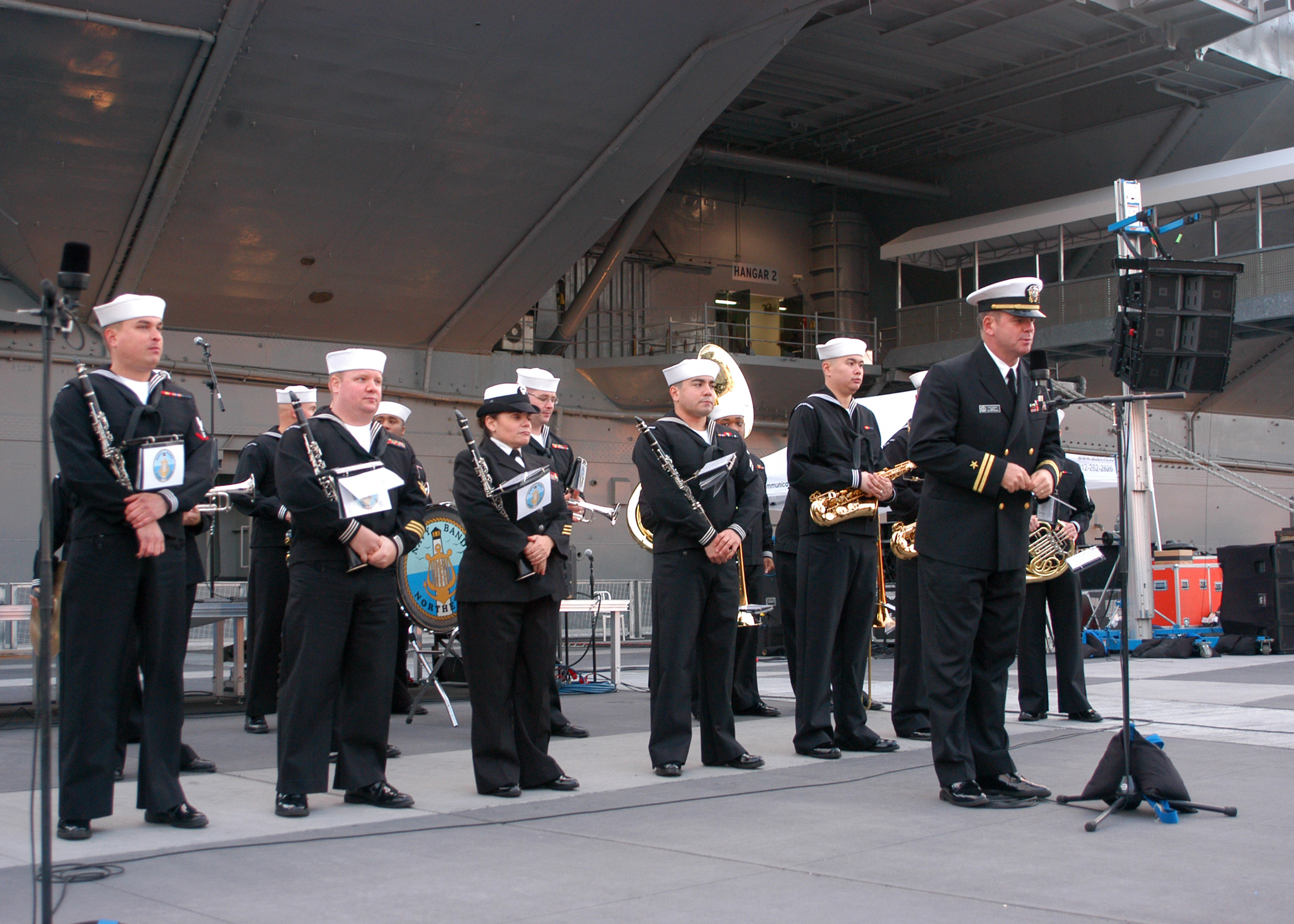 leading the group in a medley of patriotic favorites outside the newly renovated Intrepid Sea, Air ^ Space Museum in Manhattan.jpg English: NEW YORK (Nov