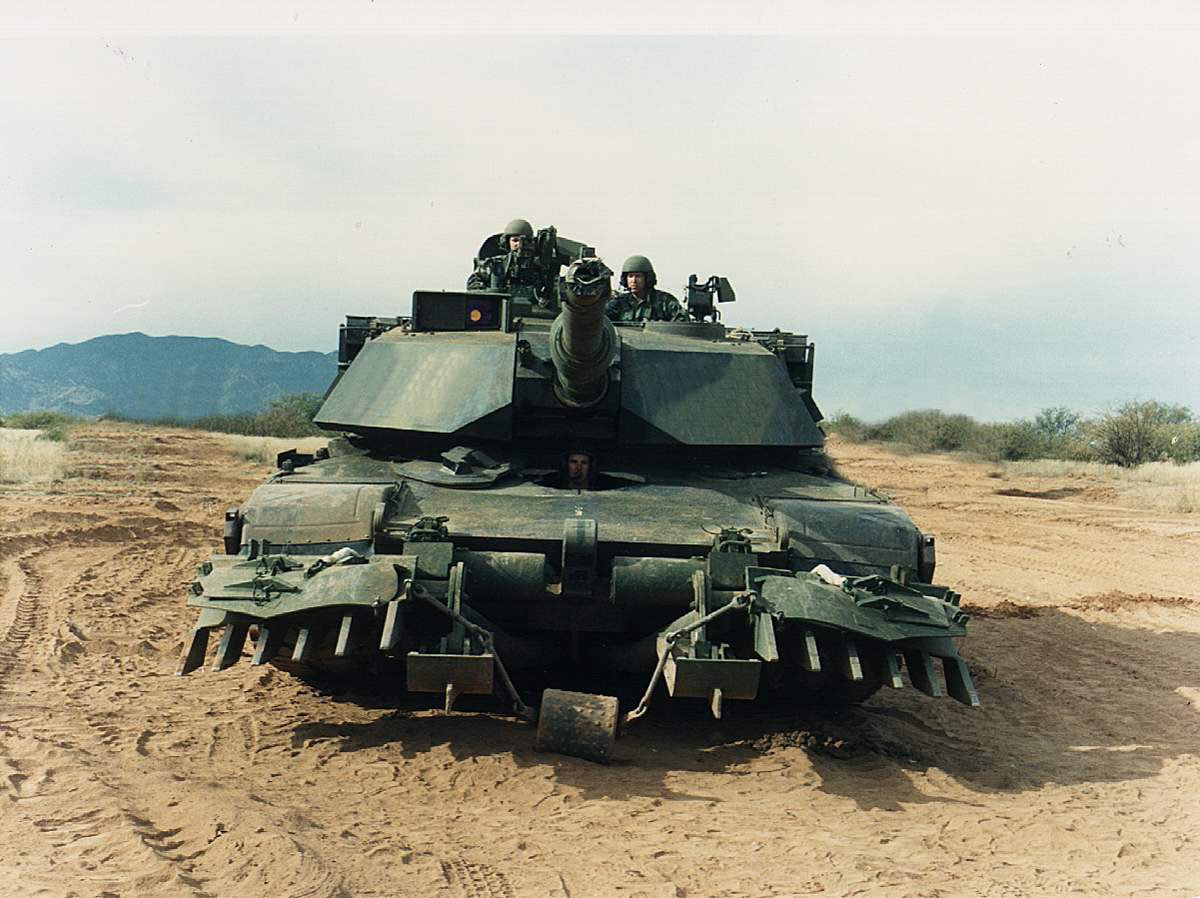 Description abrams tank with mine plow