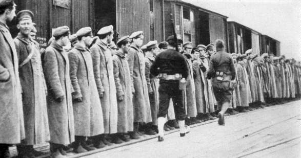 Captured Red Army soldiers guarded by US troops in Arkhangelsk, 1918.