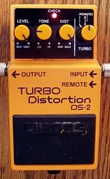 A typical BOSS compact effects pedal. This is the DS-2 Turbo Distortion pedal, a popular model of distortion pedal designed for electric guitar. Boss DS-2 Distortion Pedal.jpg