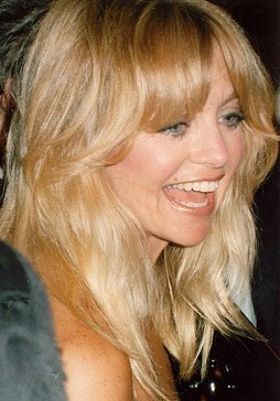 A blond-haired Caucasian woman laughing.