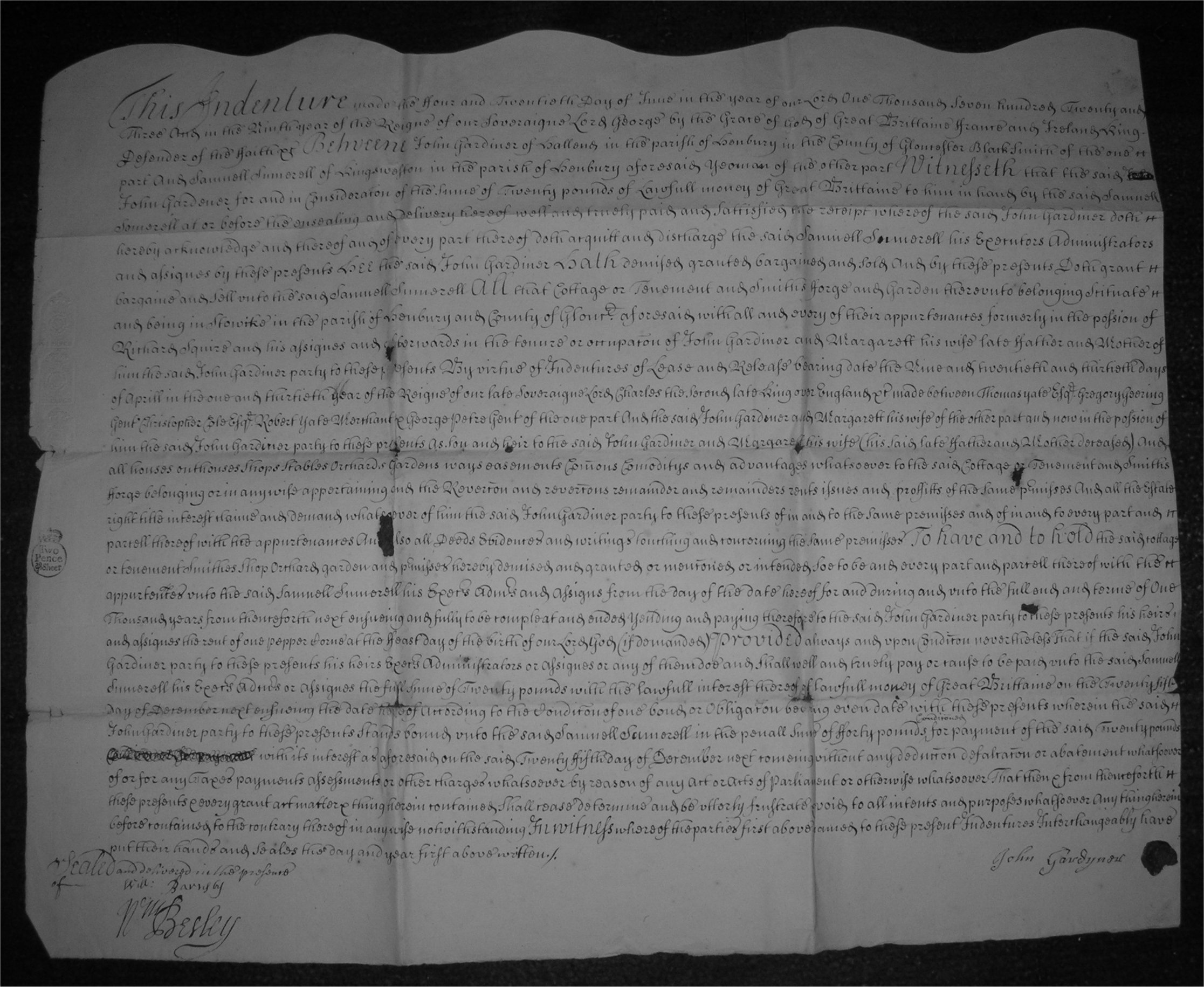 Half of an indenture document of 1723 showing the randomly-cut edge at the top