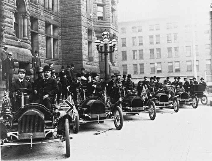 Line of Russell cars outside Toronto City Hall
