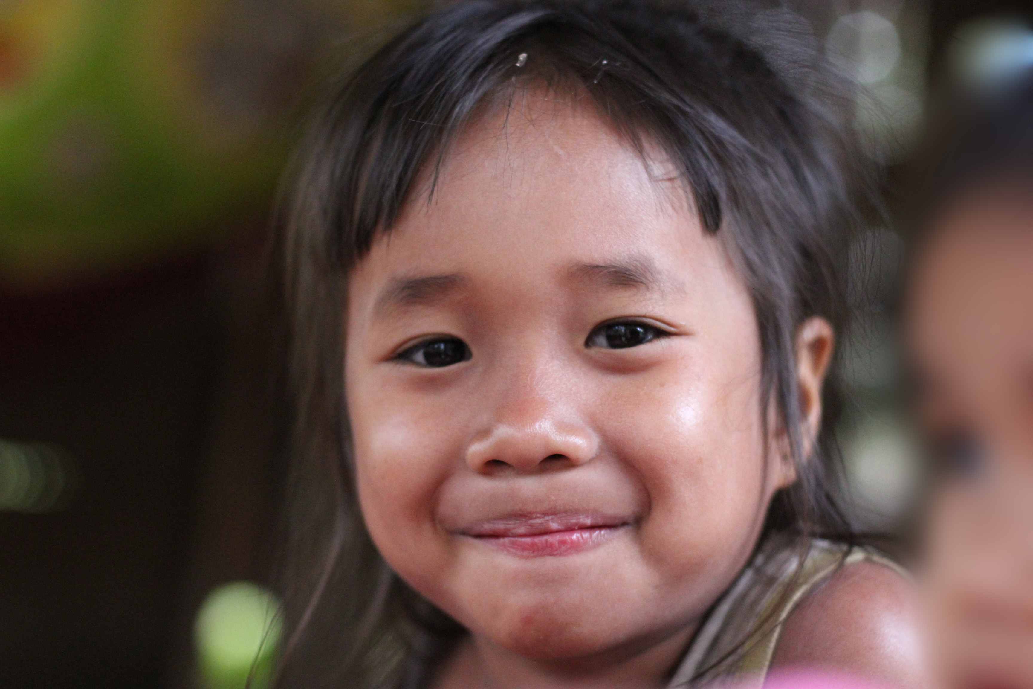 File:Little girl smiling from Don Det in Laos.jpg - Wikimedia Commons