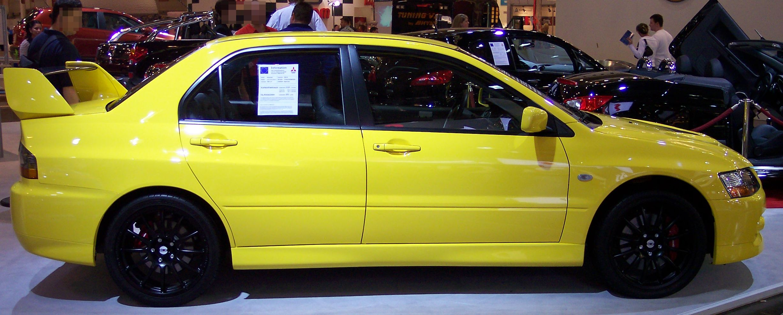 File:Mitsubishi Lancer Evolution IX yellow r EMS.jpg - Wikimedia Commons