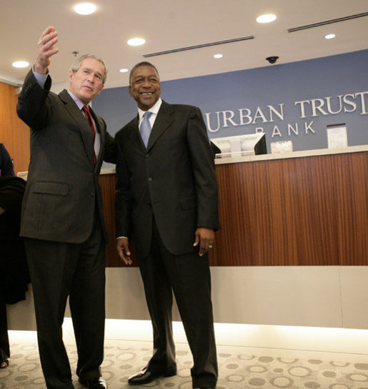 President George W. Bush is welcomed by Bob Johnson, founder and chairman of the RLJ Companies.jpg