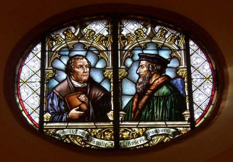 Glass window in the town church of Wiesloch (Stadtkirche Wiesloch) with Martin Luther and John Calvin commemorating the 1821 union of Lutheran and Reformed churches in the Grand Duchy of Baden. Union luthercalvin.jpg