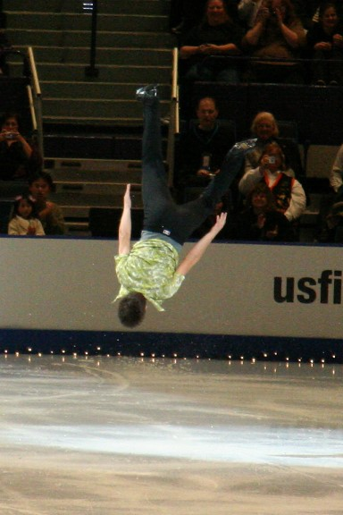 Bradley performing a backflip in exhibition at the 2006 Skate America