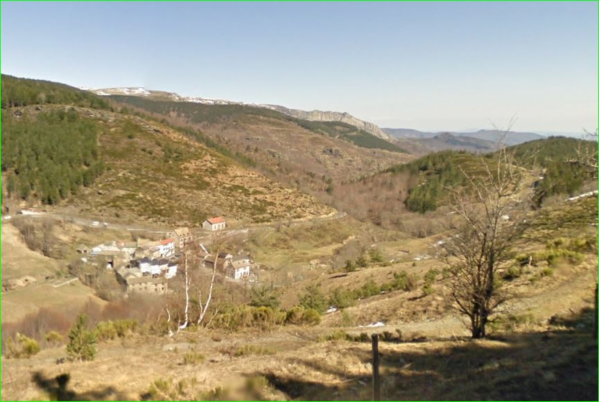 """The valley of the Luech river (fr), tributary of the Cèze river itself tributary of the Rhône river, and a view of Saint-Maurice-de-Ventalon, commune of Lozère department, region Languedoc-Roussillon. This is part of the Parc national des Cévennes. Photo taken on the D35 road, about 1 km after the """"Croix de Berthel"""" crossroad with the D998, heading south towards the """"col du Malpertus""""."""