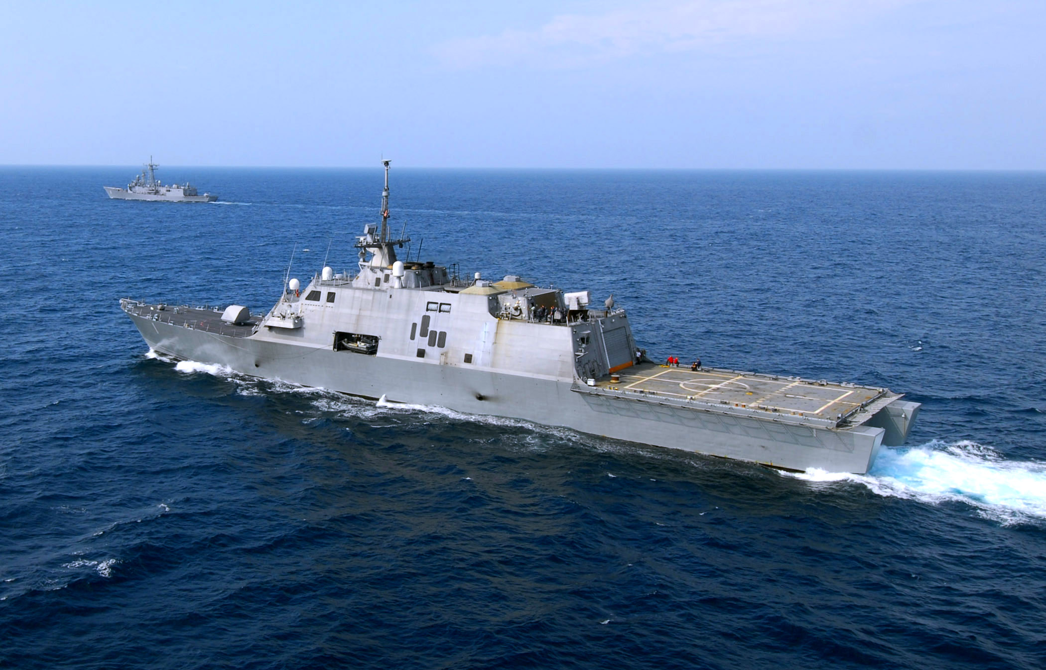 File us navy 100330 n 7058e 372 uss freedom lcs 1 maneuvers off the port quarter of the guided - Uss freedom lcs 1 photos ...
