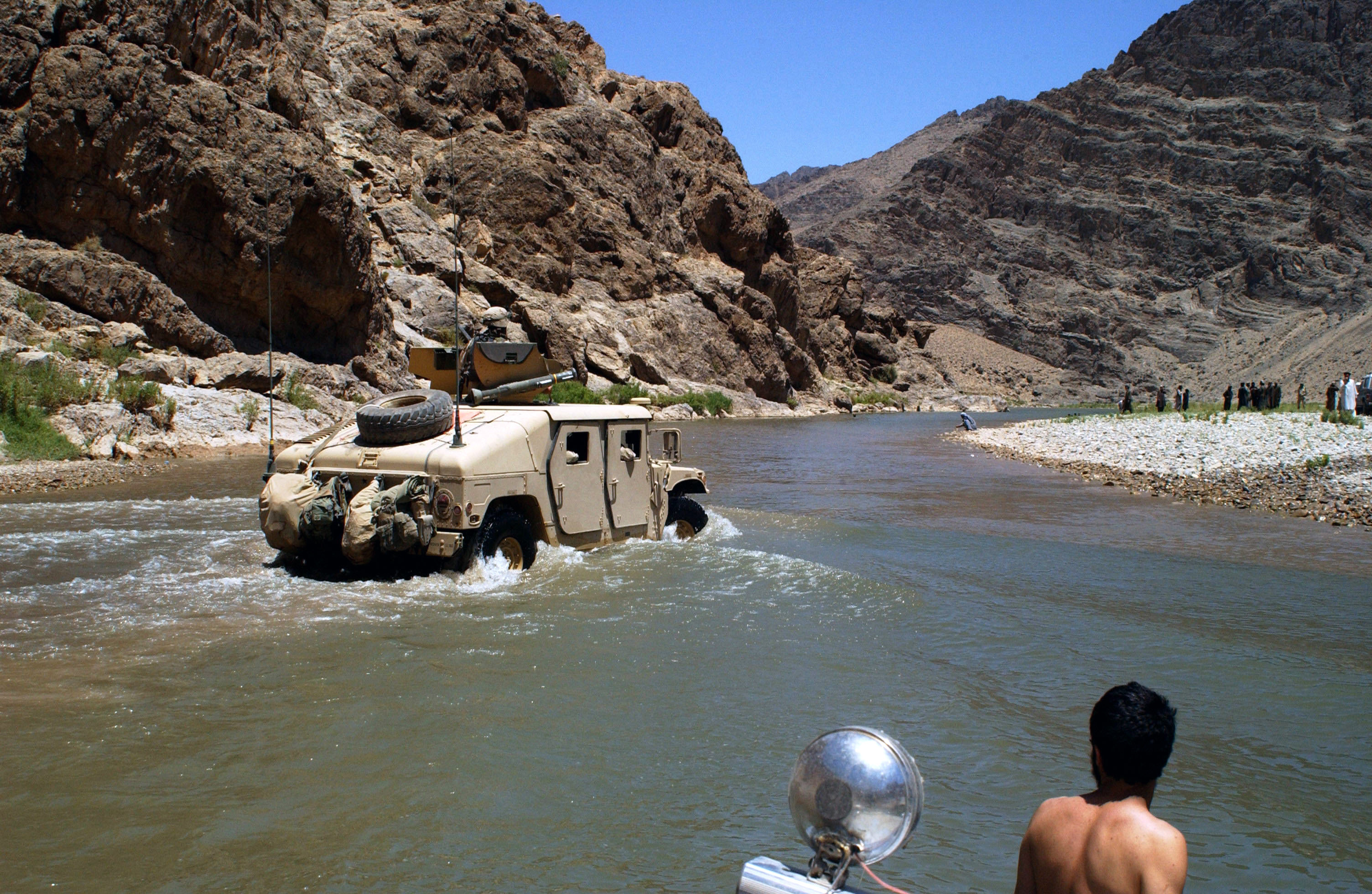 Description us humvee crossing a small river in afghanistan
