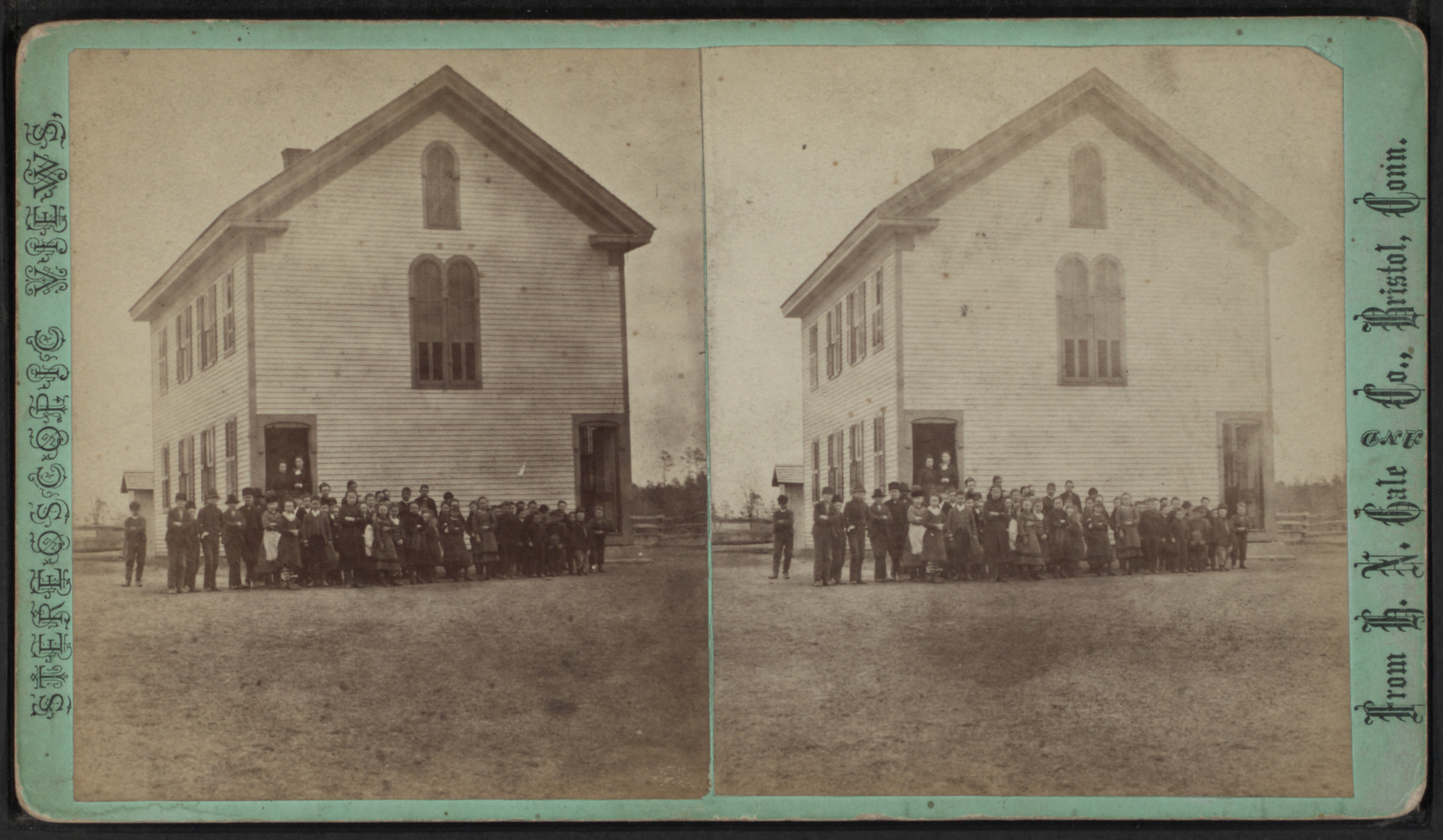 File:View of a two-story wood-frame school house with ...
