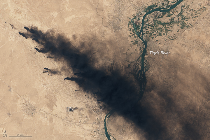 photo of burning oil fields