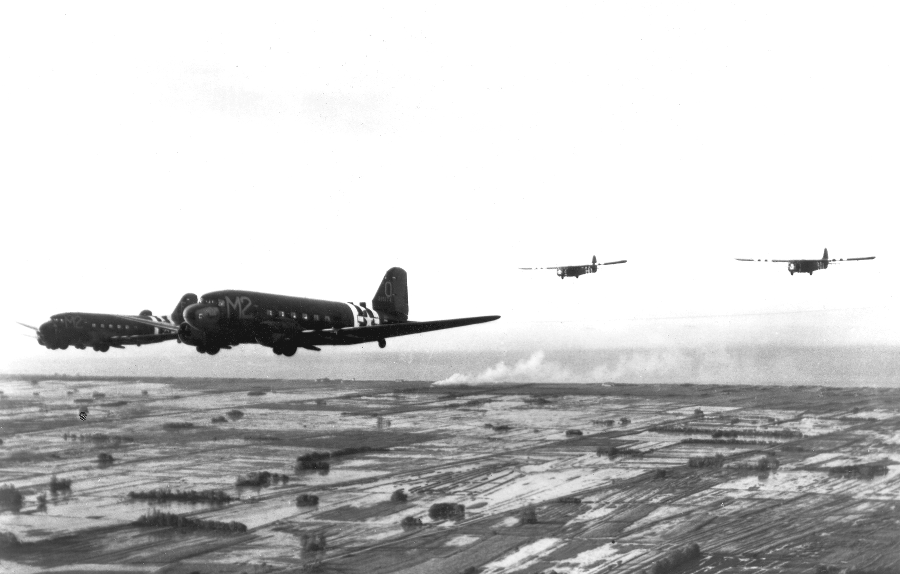 C-47As_of_88th_TCS_tow_gliders_over_Norm