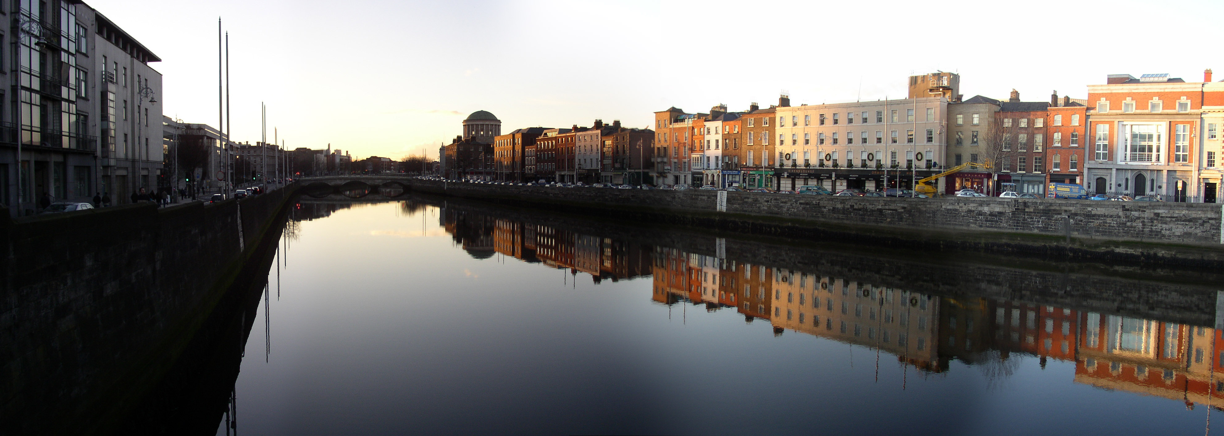 A view upstream from Grattan Bridge, towards the Four Courts (the domed building), with Essex Quay and Wood Quay on the right bank (left of picture) and Upper Ormond Quay on the left bank (right of picture).