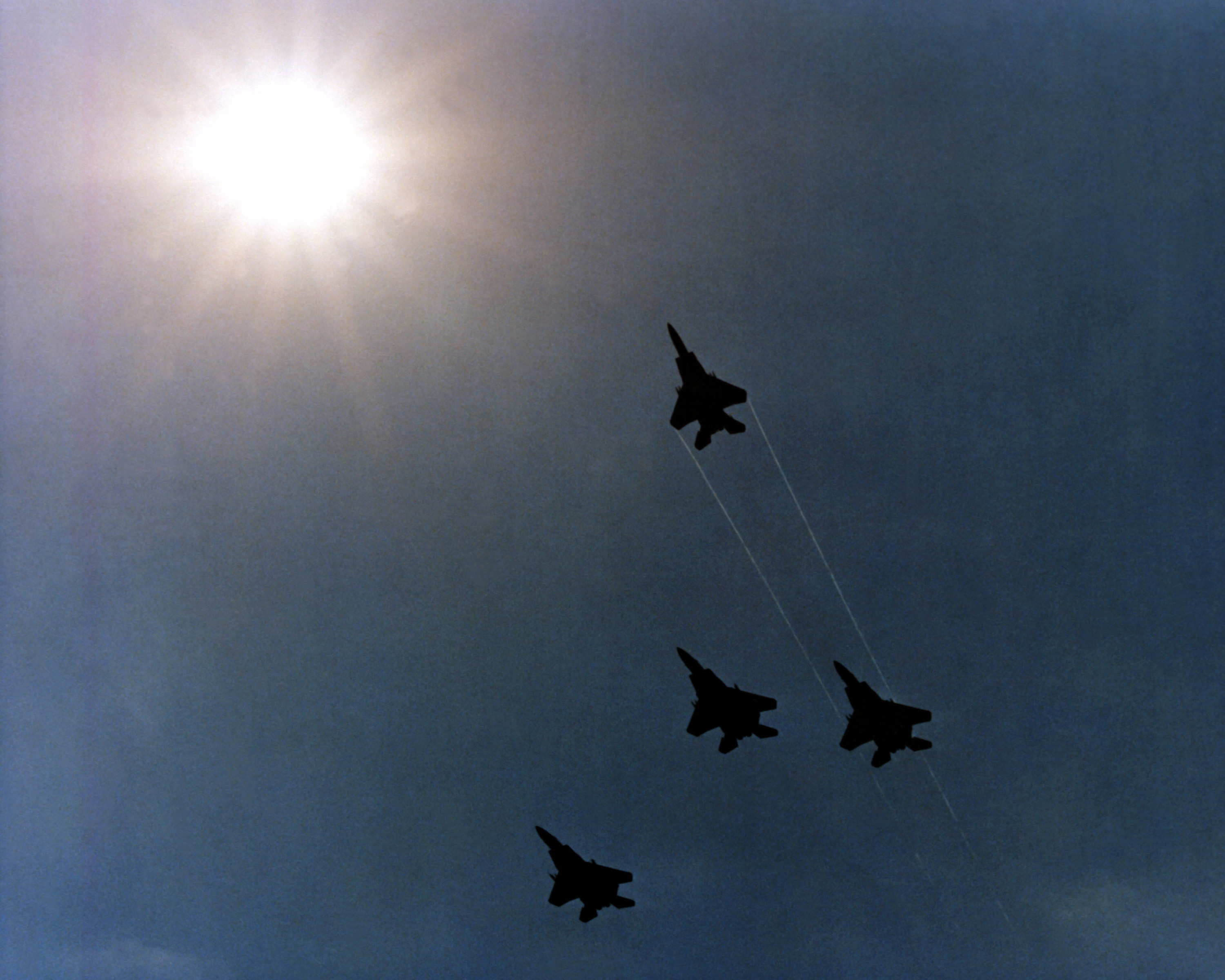 File:Four F-15 Eagle aircraft execute a Missing Man formation as.