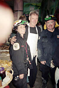 Actor Harrison Ford (center) with firefighters...