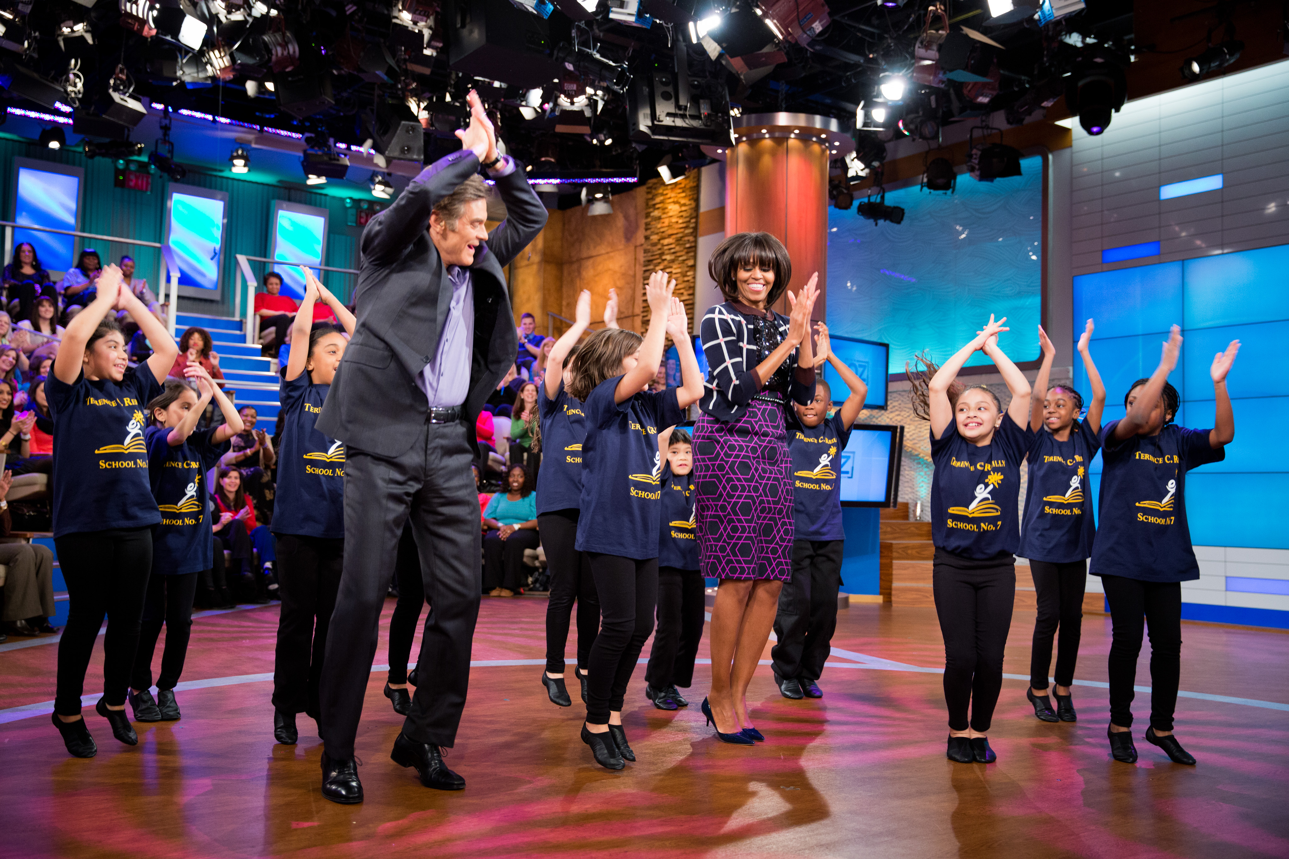"""Michelle Obama and Dr. Mehmet Oz learn a dance routine during a taping of the """"Dr. Oz Show"""", 2013.jpg"""