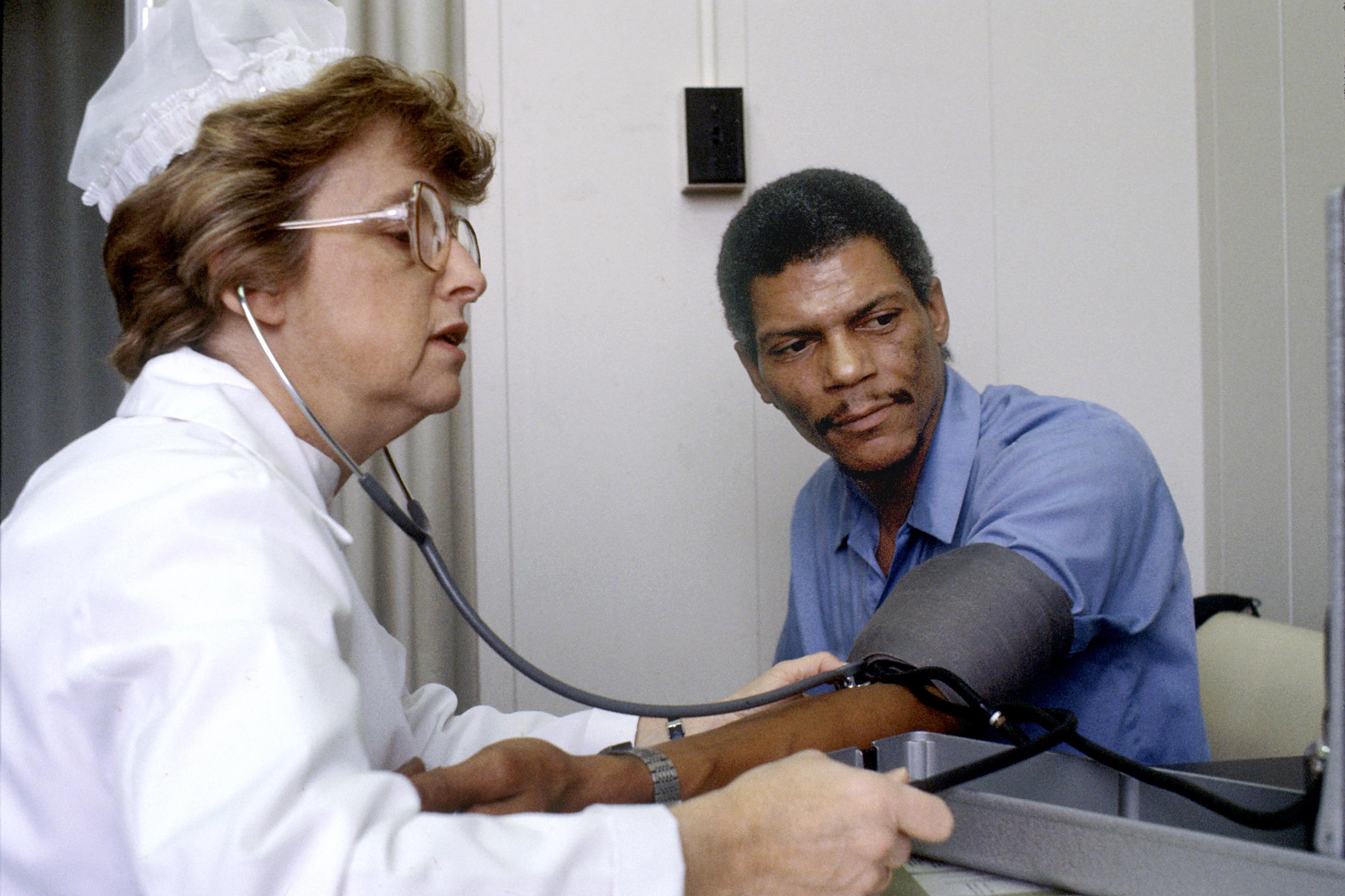 File:Nurse checks blood pressure.jpg - Wikimedia Commons