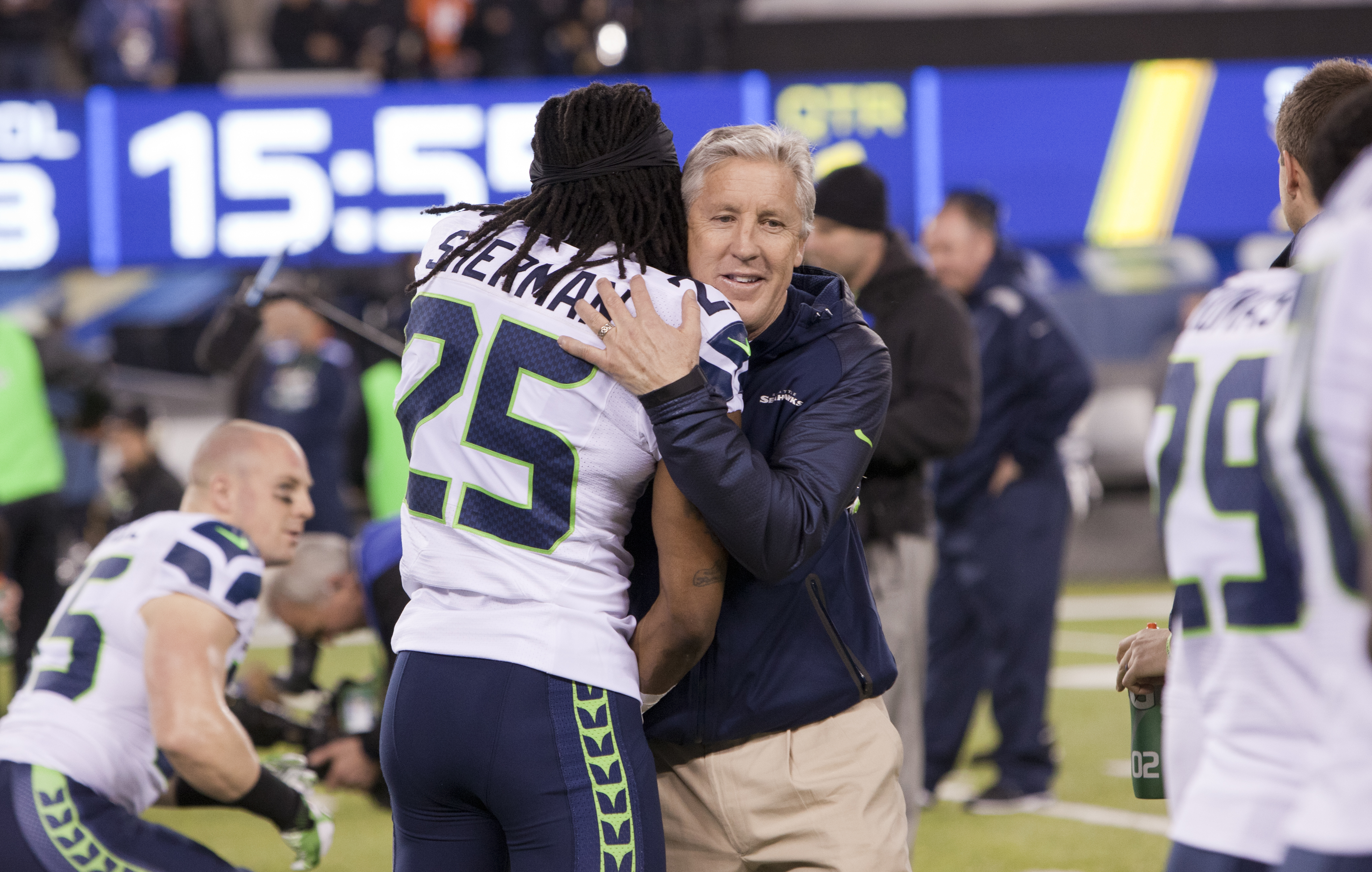 File Richard Sherman and Pete Carroll in embrace Super Bowl XLVIII