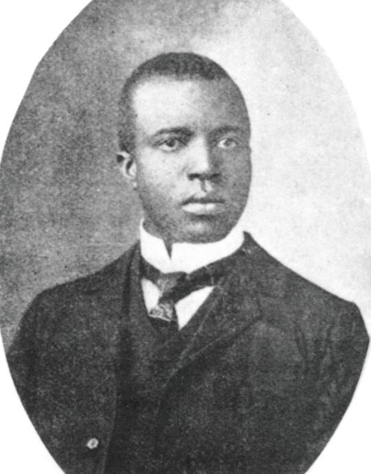 https://upload.wikimedia.org/wikipedia/commons/6/6d/Scott_Joplin.jpg