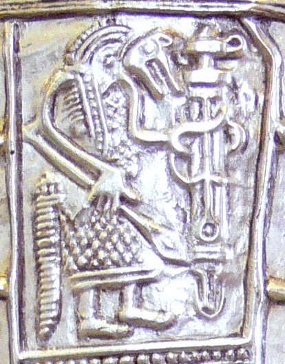 The 7th-century Gutenstein scabbard, found near Sigmaringen, Baden-Wurttemberg, is a late testimony of pagan ritual in Alemannia, showing a warrior in ritual wolf costume, holding a ring-spatha. Gutenstein warrior.jpg