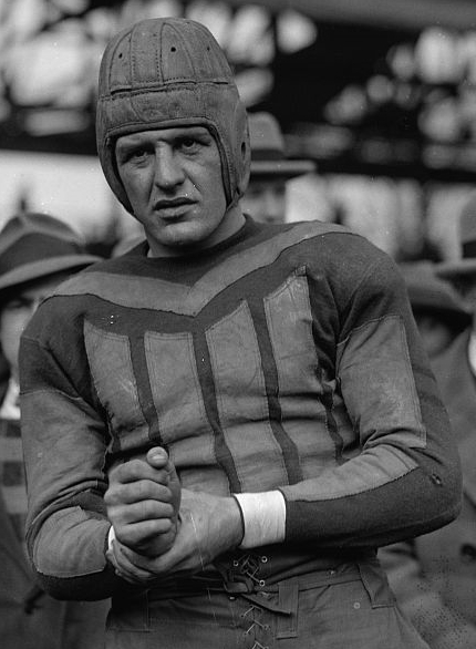 harold grange the wheaton ice man A man in uniform kneels while holding a football  in an era of colorful sports  nicknames, harold grange was such a gridiron  the granges left pennsylvania  in 1908 for wheaton, illinois, shortly after the future hall of famer's mother died   to build strength and endurance, grange delivered heavy blocks of ice from  door.