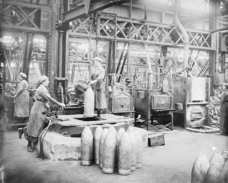 Female munitions workers manufacturing heavy artillery shells, 1917