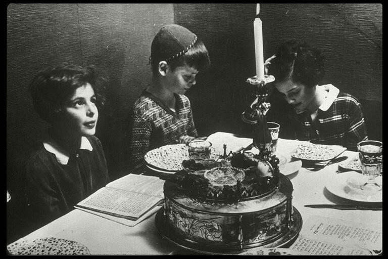 Children around the table at a Passover Seder meal