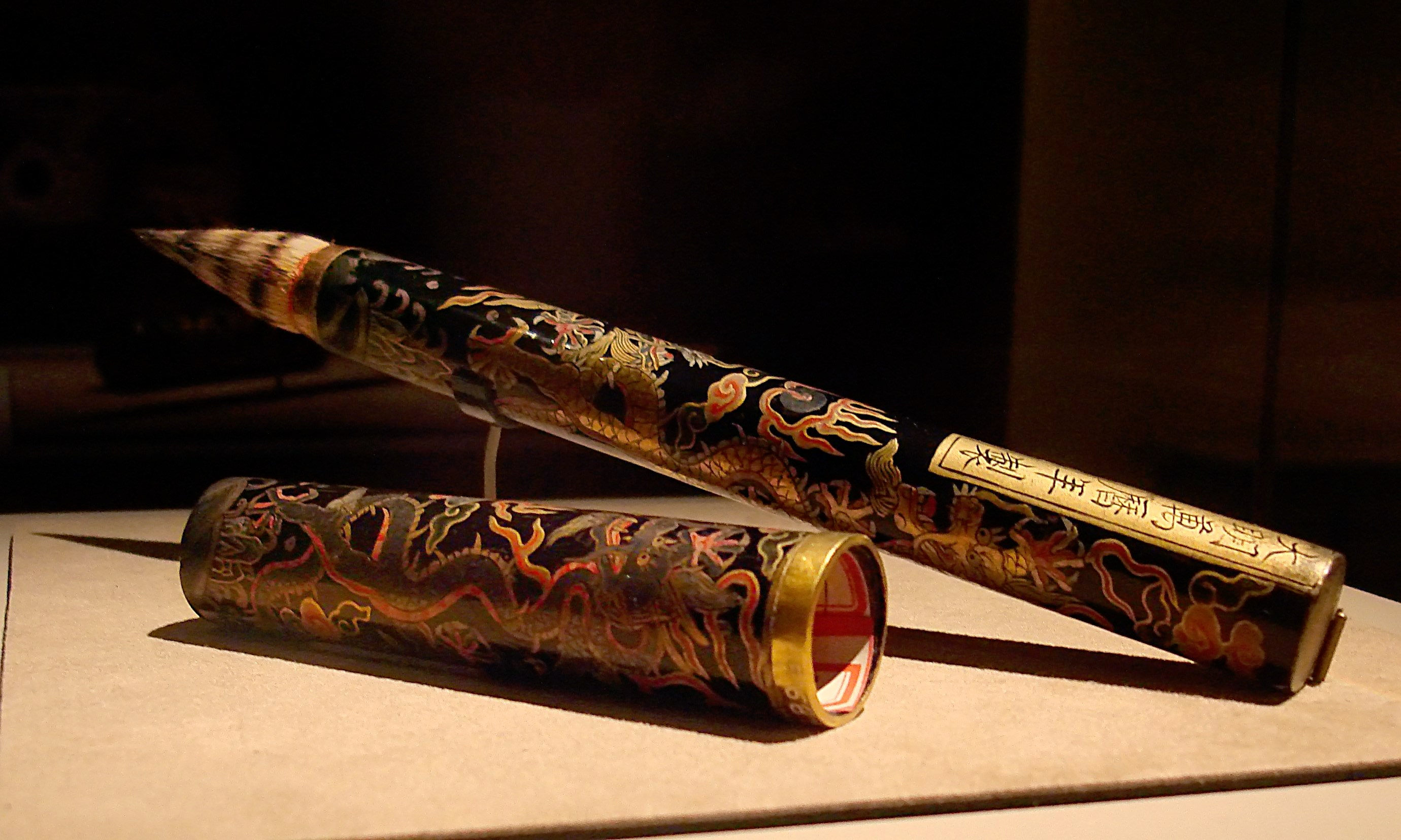 CMOC Treasures of Ancient China exhibit - calligraphy brush with dragon design.jpg