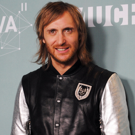 The 49-year old son of father (?) and mother(?), 176 cm tall David Guetta in 2017 photo