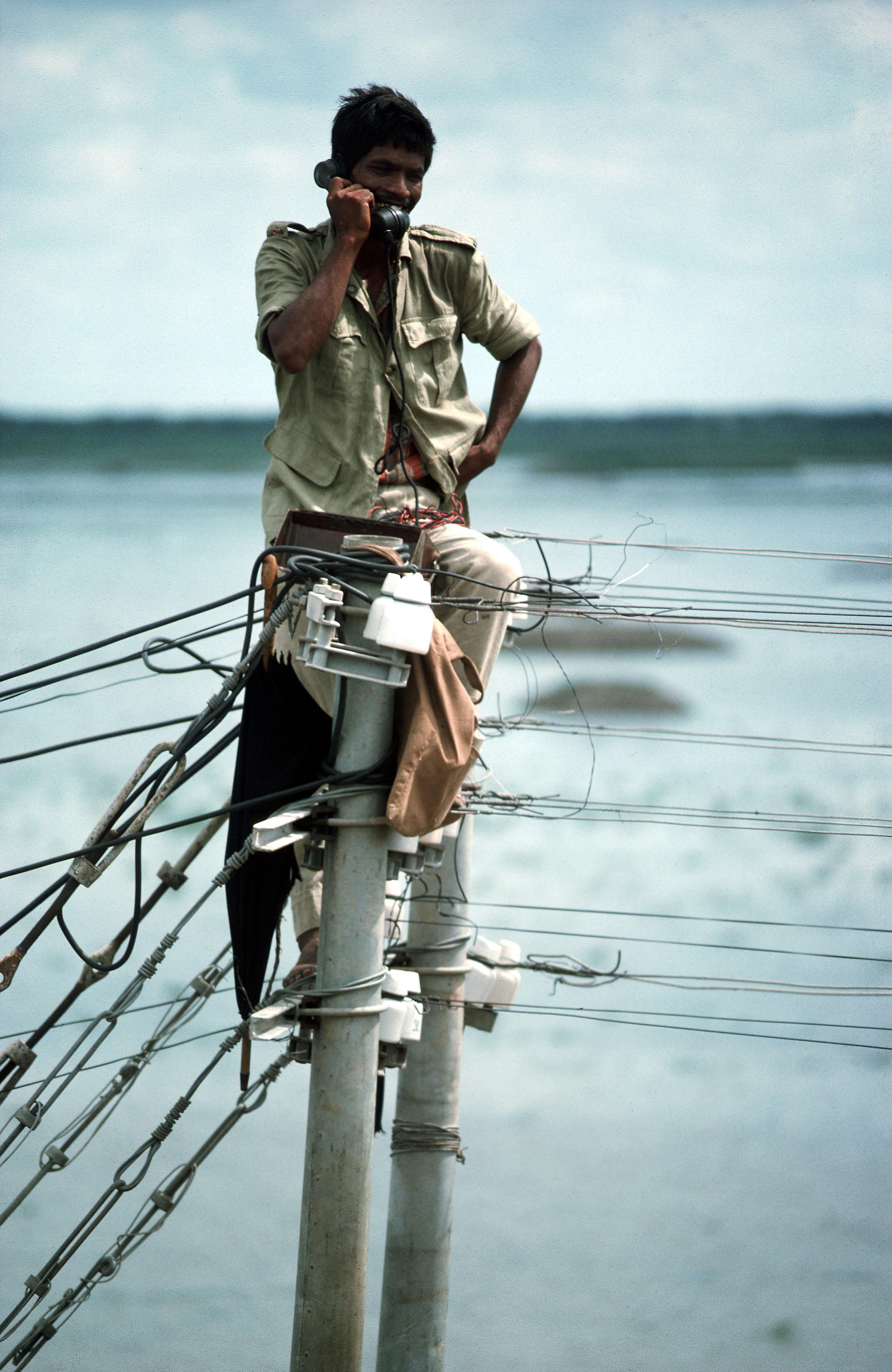 File:Telephone technician checking lines. Savar region, north of ...