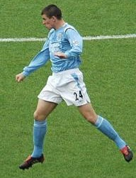 Joey Barton heading a ball during a match in 2004.