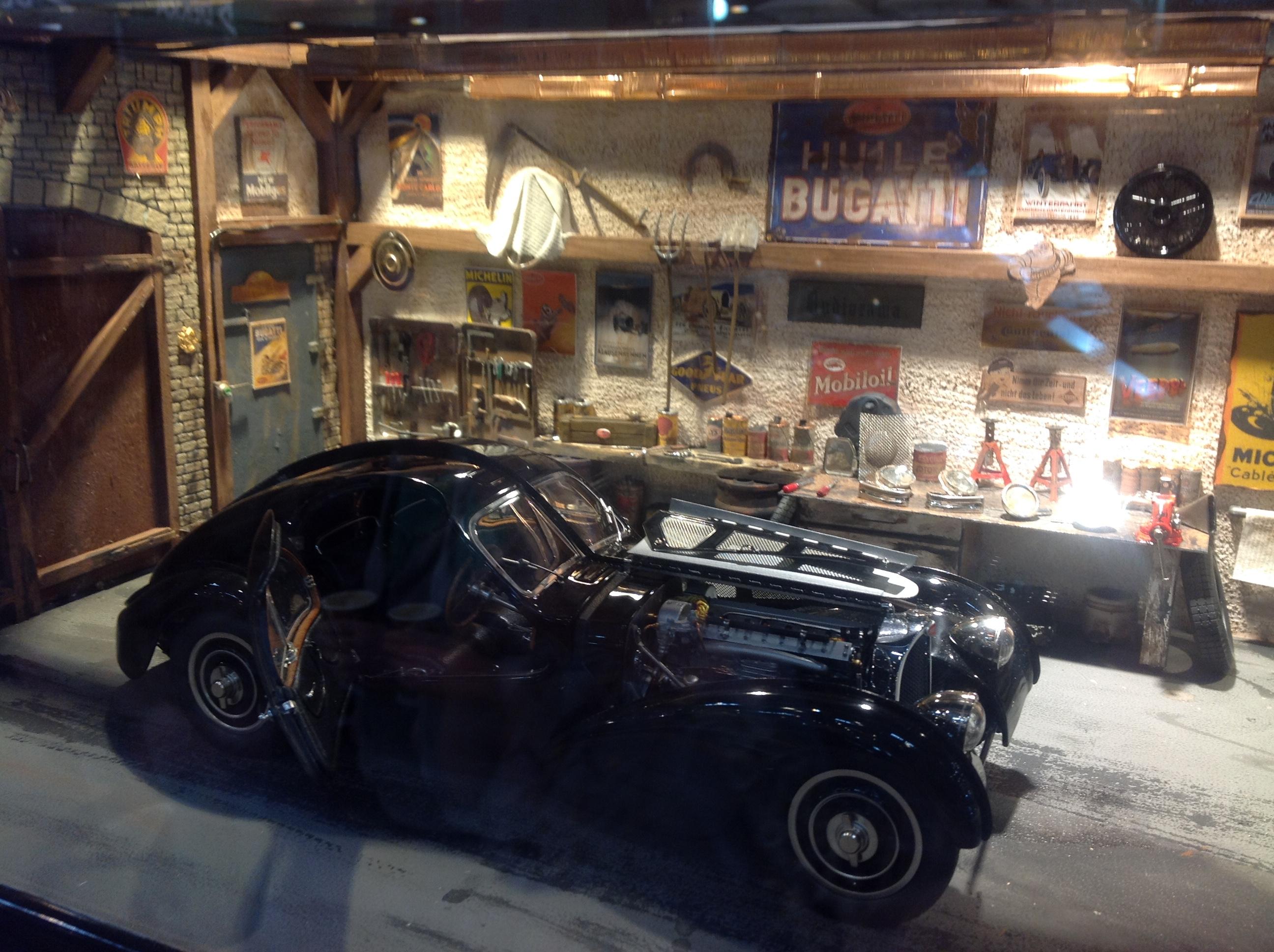 File cmc model diorama featuring garage containing bugatti