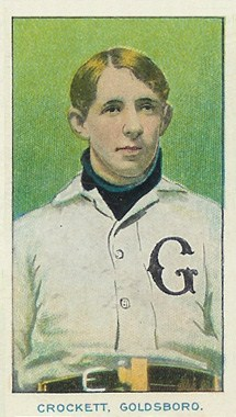 "A baseball card of a man wearing a high-collared white baseball jersey with a black ""G"" on the left breast."