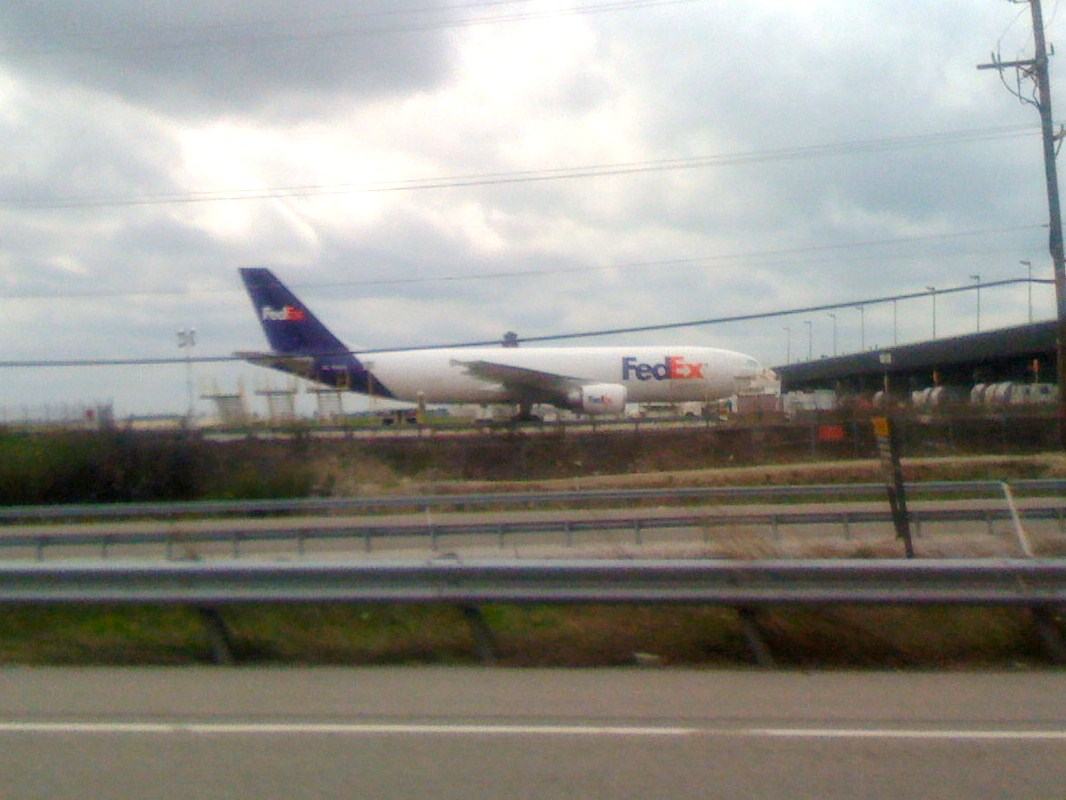 FedEx Express Airbus A300 plane parked at a cargo gate.