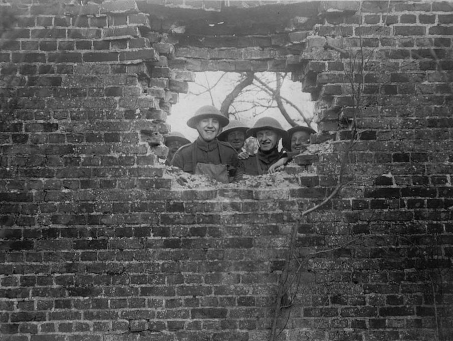 Shell hole, Western Front. Soldiers laughing as they peer through a shell hole in a brick wall. Their cheerful faces and the lighthearted caption are at odds with the truth that the constant shelling was one of the most difficult aspects of the war for many soldiers. Many men suffered severe mental distress from shell-shock, a condition which the army tried, at first, to deny.As the war progressed, heavier guns could fire shells over the heads of their own side and far into the enemy lines. By the end of the war, for example, some of the howitzers could fire shells weighing 2000 pounds (900 kilos) over distances of 11 miles (18 kilometres). [Original reads:  'It just missed us.'] http://digital.nls.uk/74549282