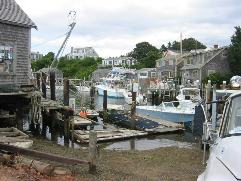 Fishing cottages and boats on Menemsha's harbor.