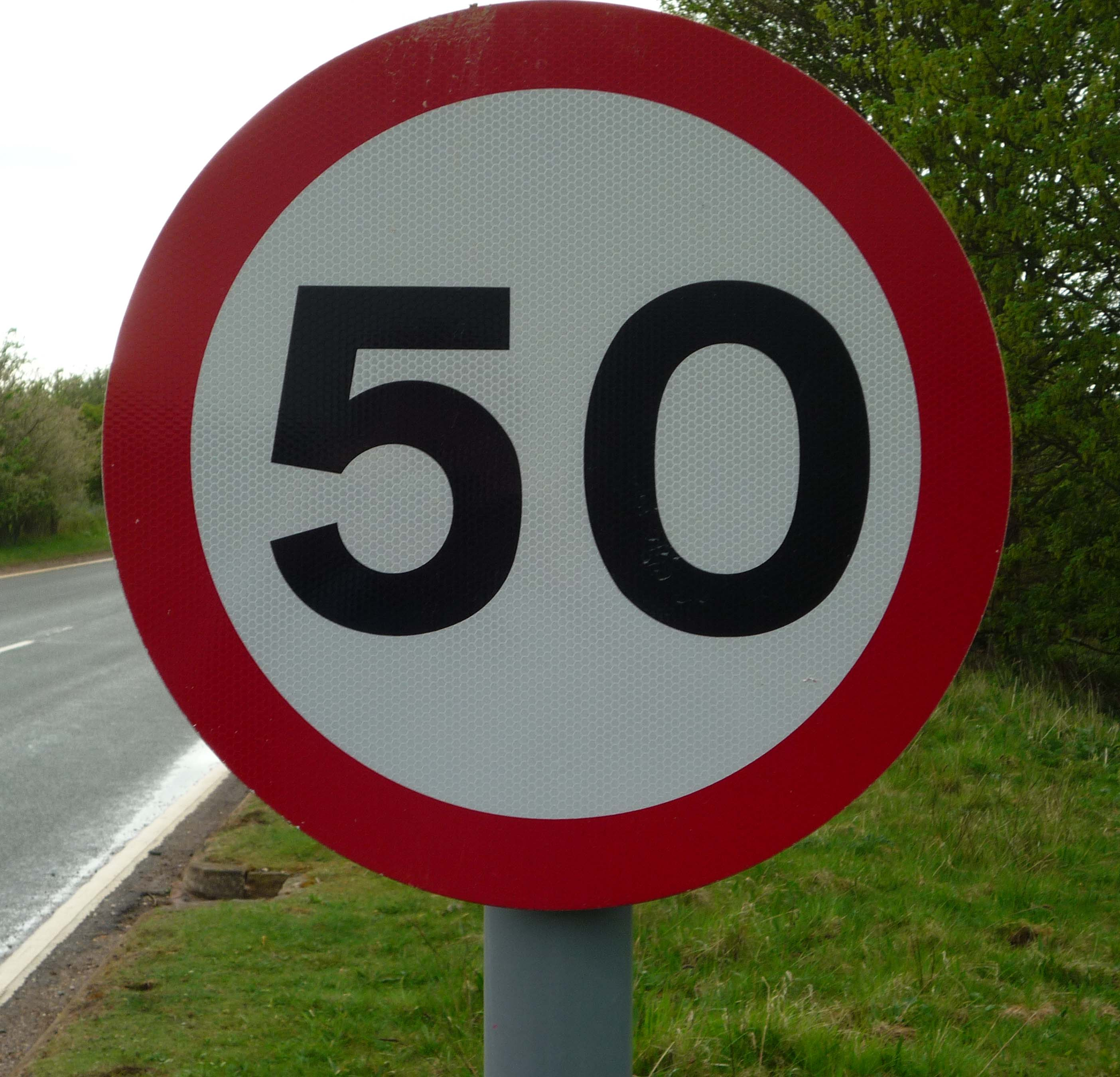 This image has an empty alt attribute; its file name is UK_50_mph_speed_limit_sign.jpg