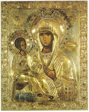 アトス山のヒランダリウ修道院にある生神女マリヤのイコン。ダマスコの聖イオアンによるイコンの構図で、「三本手の生神女」と呼ばれるタイプである。左下に生神女のものではない手が描かれている。聖像破壊運動の時代、東ローマ帝国皇帝の策略によってイコンを描く手を切り落とされた聖イオアンであったが、生神女の庇護により手が回復したという奇蹟があったと伝えられる。この奇蹟に感謝してイオアンが手を描き加えたのがこのイコンの構図の始まりだとされる。