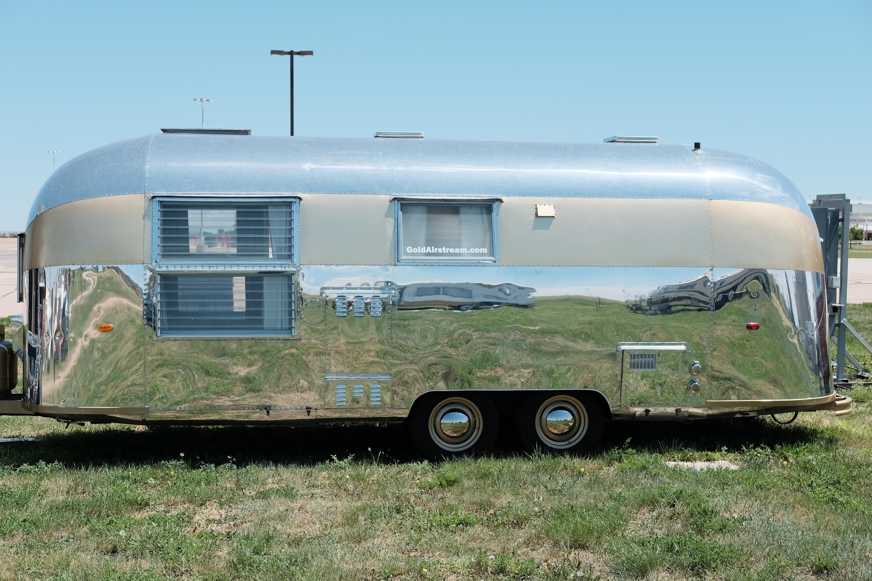 File:1962 Airstream Tradewind custom gold 24 foot travel ...
