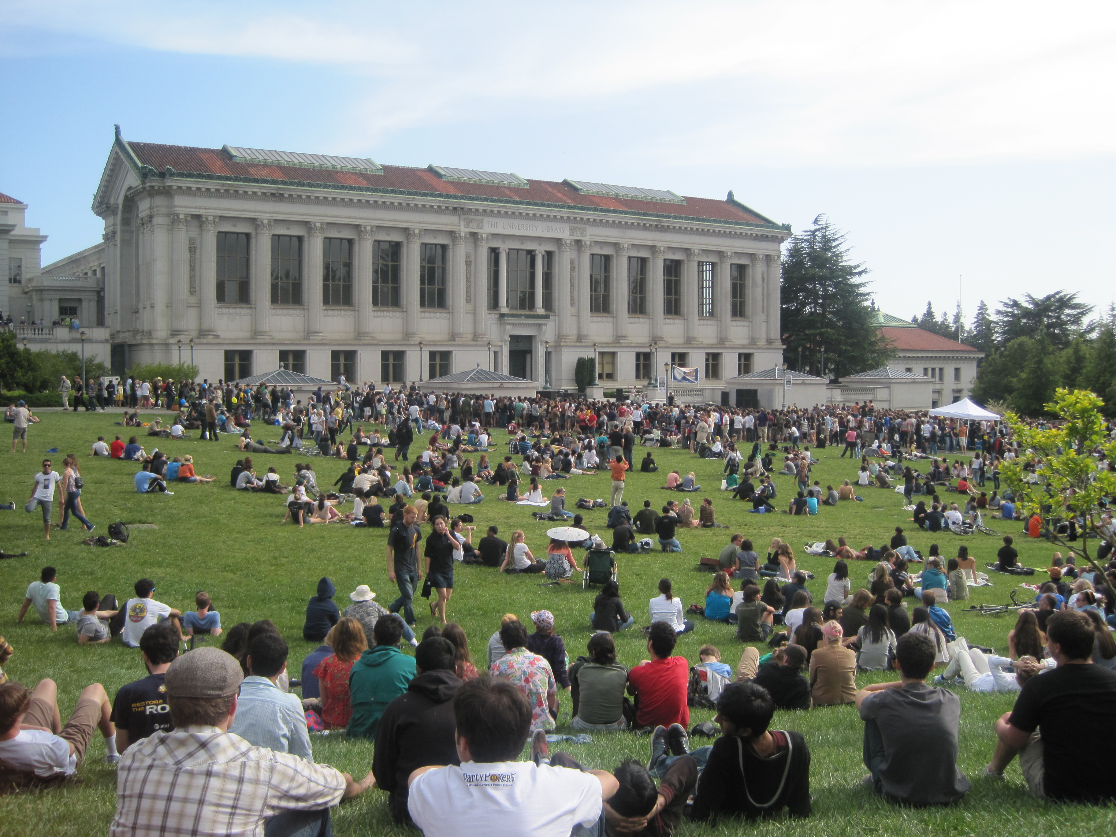 students gathered on the Memorial Glade to watch a concert