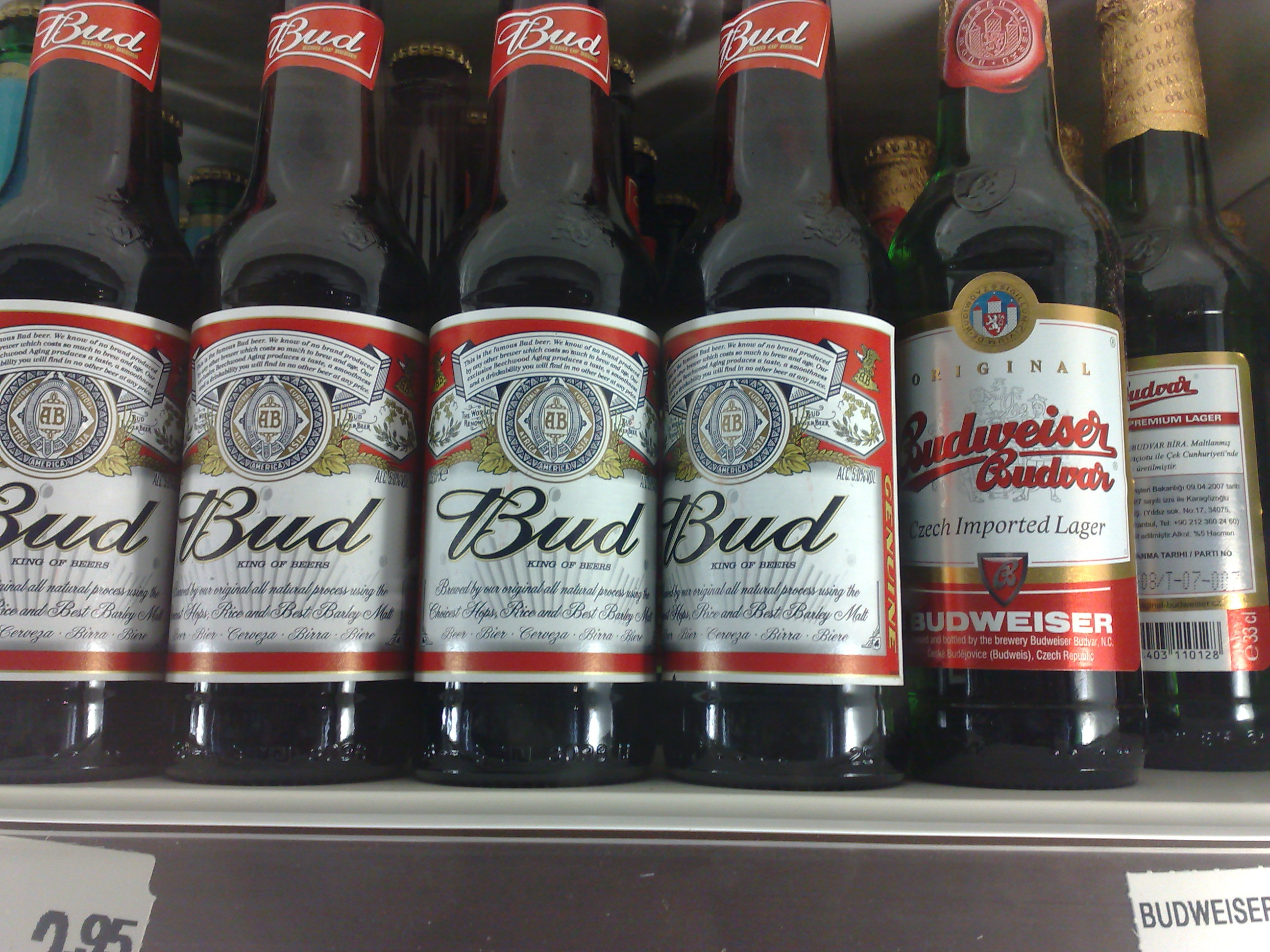 A shelf of bottled Budweiser beers