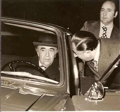 Hoveyda often chose to drive himself to work and around town in a Paykan. His security detail often sat in the back seat. shown here with his Chief of Staff, Abdol Ali Ghaffari Hoveyda and his car.jpg