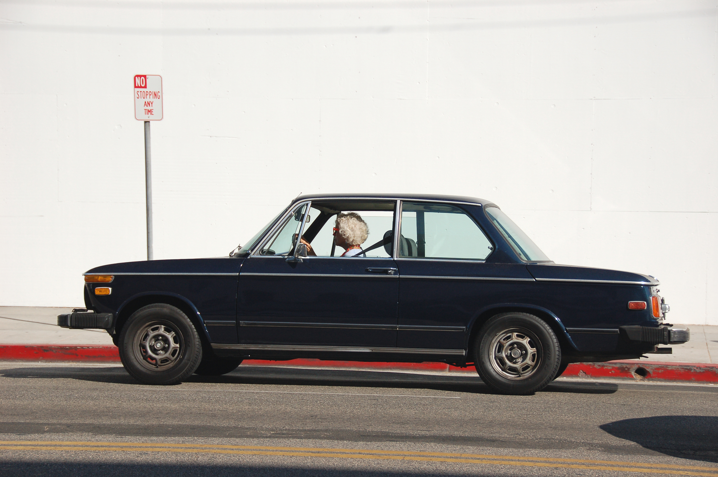 File:Old woman driving blue car (Unsplash).jpg - Wikimedia Commons