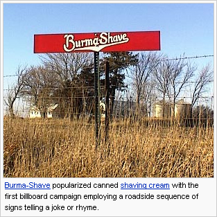 Small red sign with Burma Shave logo, near a fence in a field